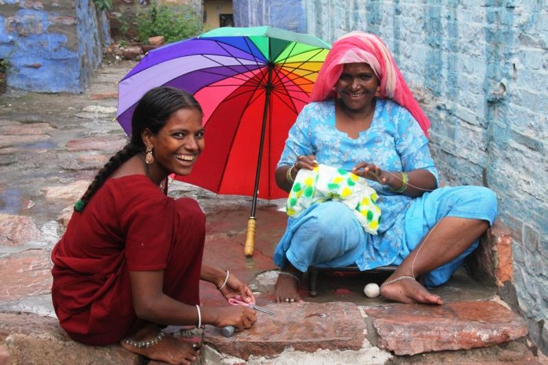 Jodpur woman umbrella sitting_BLOG